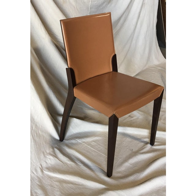 Set of Six Leather Dining Chairs by Cattelan Italia. These chairs could use a cleaning but we chose to leave that to the...