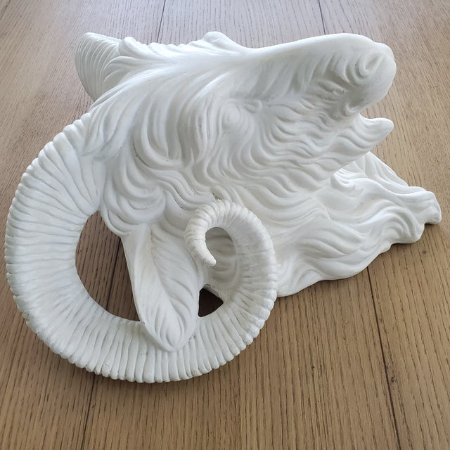 A striking vintage French off-white/eggshell plaster rams head wall decor. The piece is fitted to hang and is quite large...