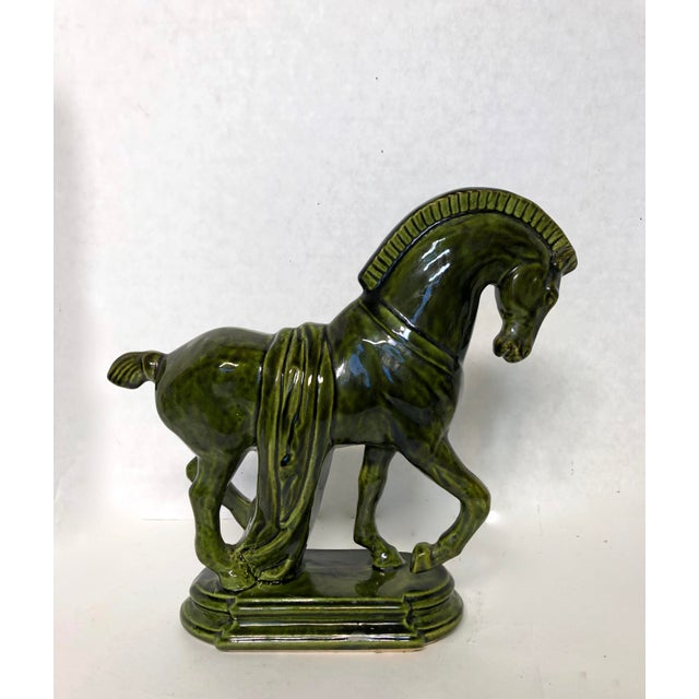 This is a hand made Oriental ancient style horse figure in emerald green glaze finish. Beautiful piece ... upon very close...