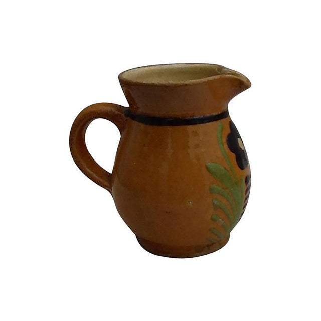 19th century pottery pitcher with flower decoration from Savoie, France. Some wear.
