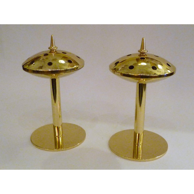 Rarely seen, this pair of solid brass candlesticks designed by Hans Agne Jakobsson for Markaryd Sweden are extraordinary....
