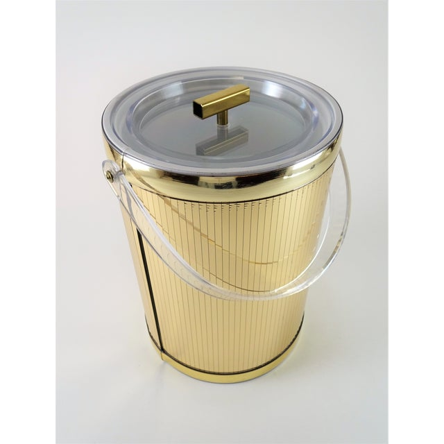 Mid Century modern Gold Lucite Ice bucket. Designed by American designer Georges Briard. A rare find. A must-have piece...