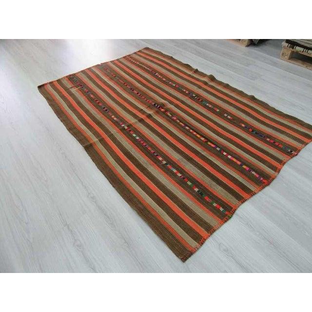 Vintage Brown and Orange Striped Decorative Turkish Kilim Rug - 4′9″ × 7′3″ - Image 5 of 6