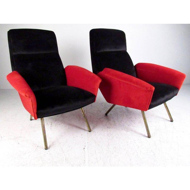 This uniquely sculpted pair of contemporary modern lounge chairs feature stylish Italian design, comfortable upholstered...