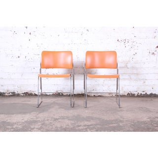 David Rowland 40/4 Orange and Chrome Stacking Chairs, Pair Preview