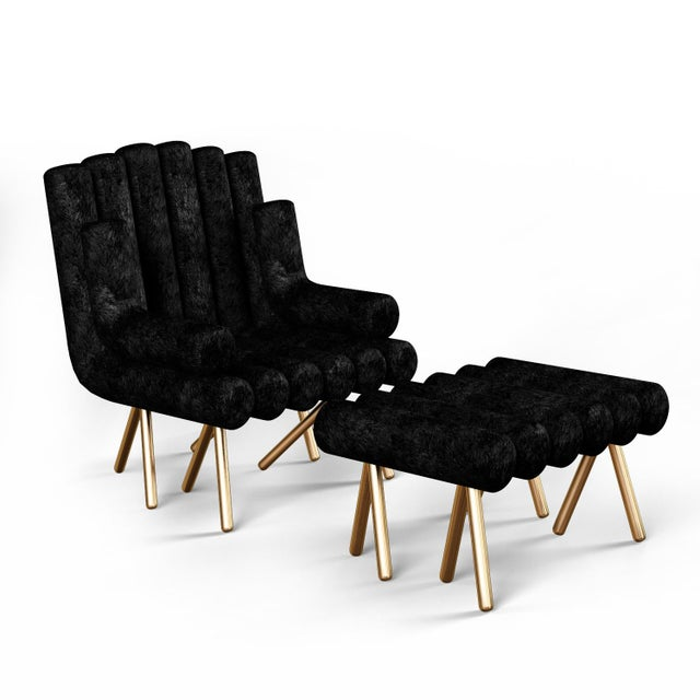 "Custom lounge chair with solid brass legs, available in cognac leather, black horse hair, or emerald velvet. 18"" Seat..."