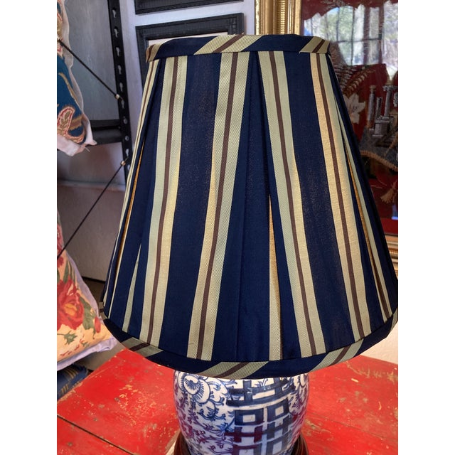 """A hand pleated lampshade made from vintage stripped necktie silk. Measurements: top 7"""" side 11.5"""" bottom 14"""""""
