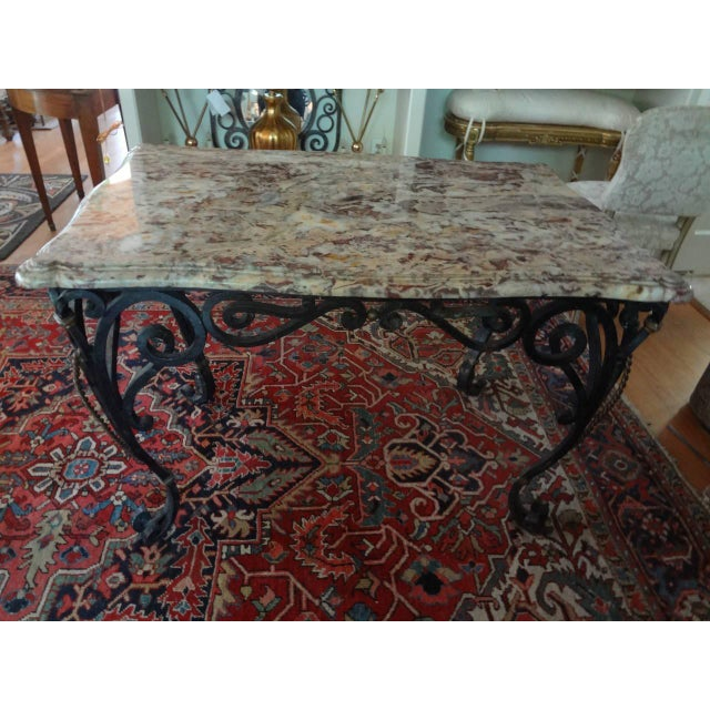 Beautifully hand-forged antique French rectangular wrought iron console table/centre table with gilt iron accents...