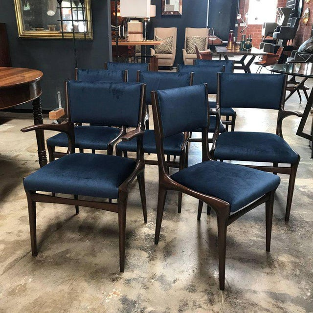 A set of eight Carlo de Carli dining chairs including two chairs with armrest. Reupholstered.