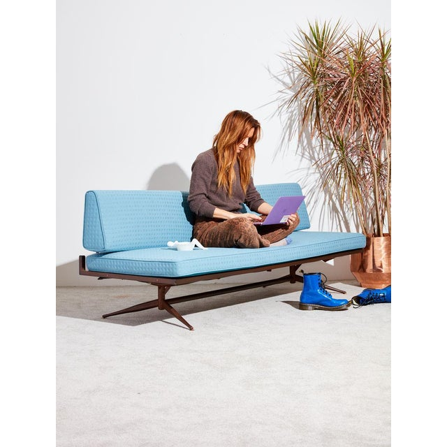 Circa 1950's daybed by housewares design company, Baumritter. Reupholstered in nice spongey blue polka-dot fabric by...