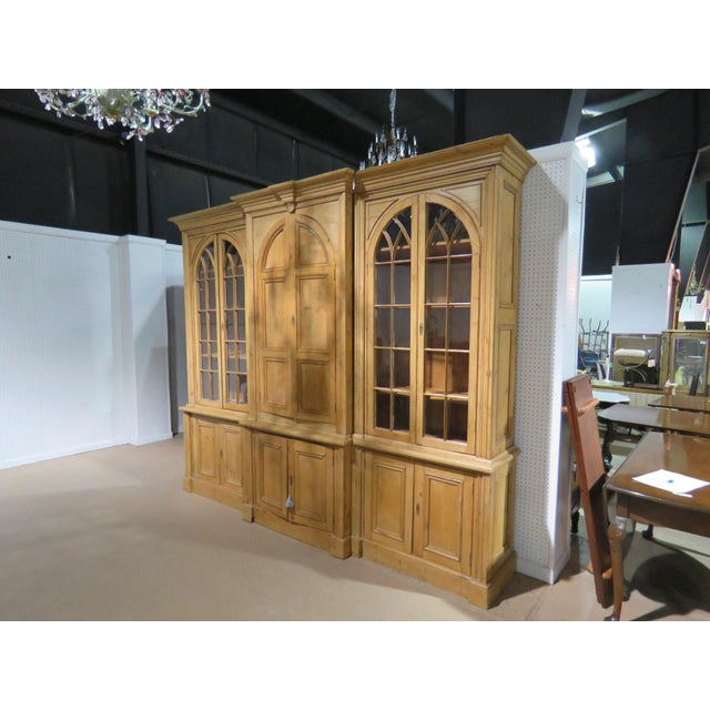 Country French pine breakfront. The top side doors have 3 shelves on each side, and the center doors have 2 shelves. The...