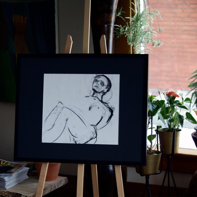 This original piece of art is from our series of figures. The art is in a gallery style frame, with glass and black matte...