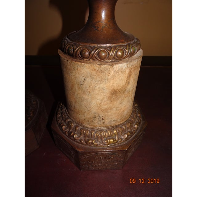 Wonderful pair of French tole and brass lamps. The tole is faux painted in cream colors. Urn shape on a pedestal. US...
