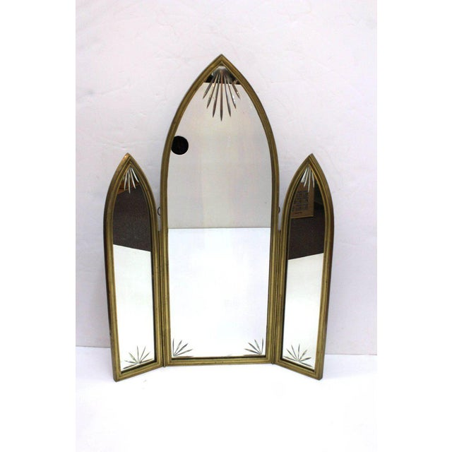A French Art Deco tri-fold mirror in bronze with etched glass. One central panel flanked by two side panels. Would look...