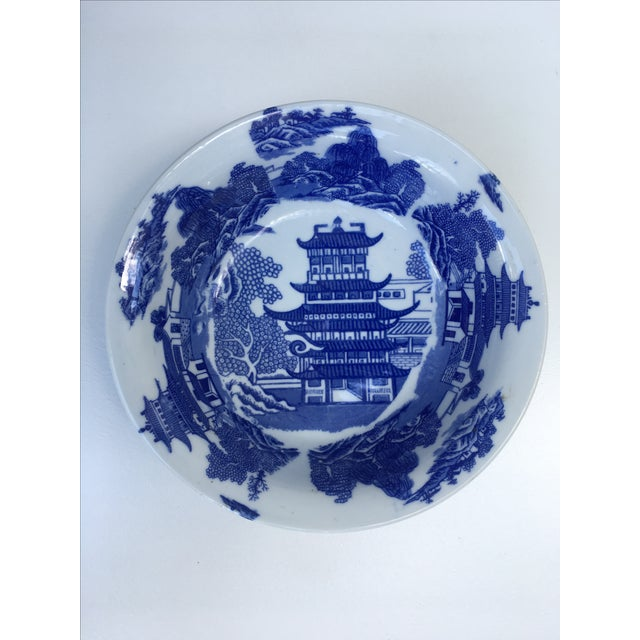 Remarkable original flow blue transfer ware piece. Blue willow pattern large serving bowl marked Victoria Ware Ironstone....