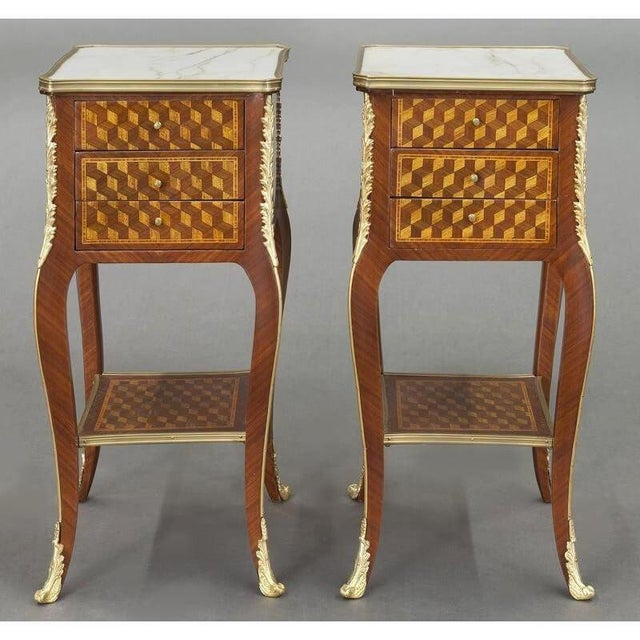 Place this elegant pair of antique nightstands on both sides of a bed for a sophisticated, symmetrical look. Crafted in...