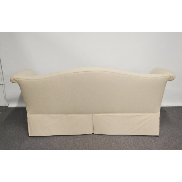 Vintage loveseat has been upholstered in a neutral linen. Clean lines with no welting and a high skirt.