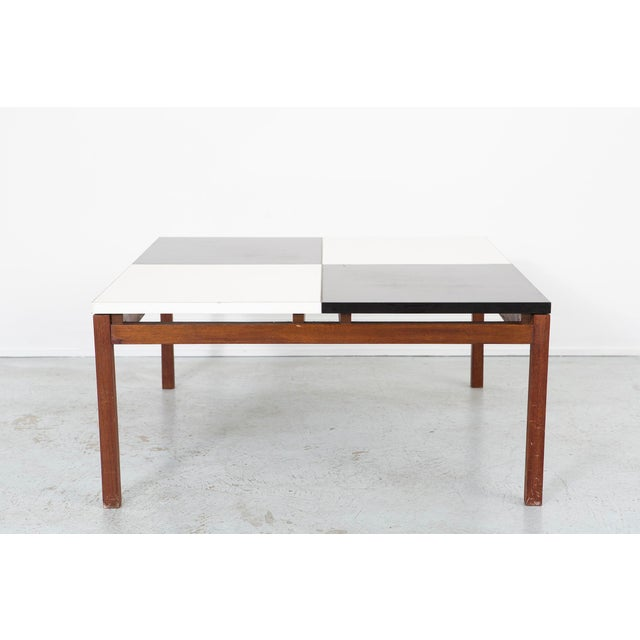 A coffee table designed by Lewis Butler for Knoll in the USA, c 1960s made of walnut with a laminate top.