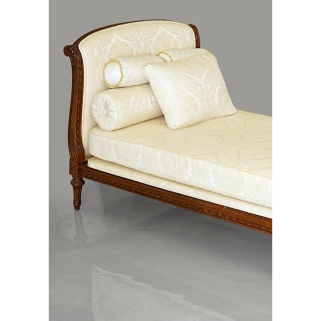 A wonderful upholstered Mahogany daybed with cream colored fabric and gorgeous carved Mahogany frame. In very good...