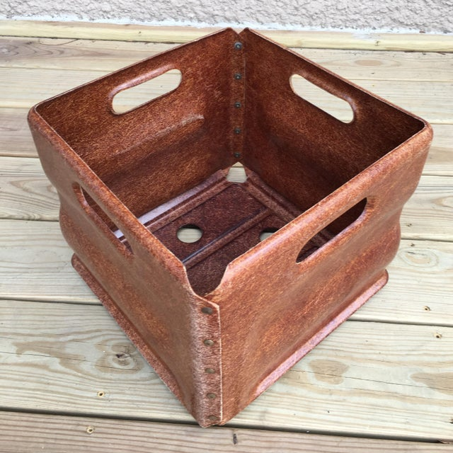 Cognac colored industrial fiberglass tote made from asymmetric molded fiberglass panels joined with brass rivets. Would be...