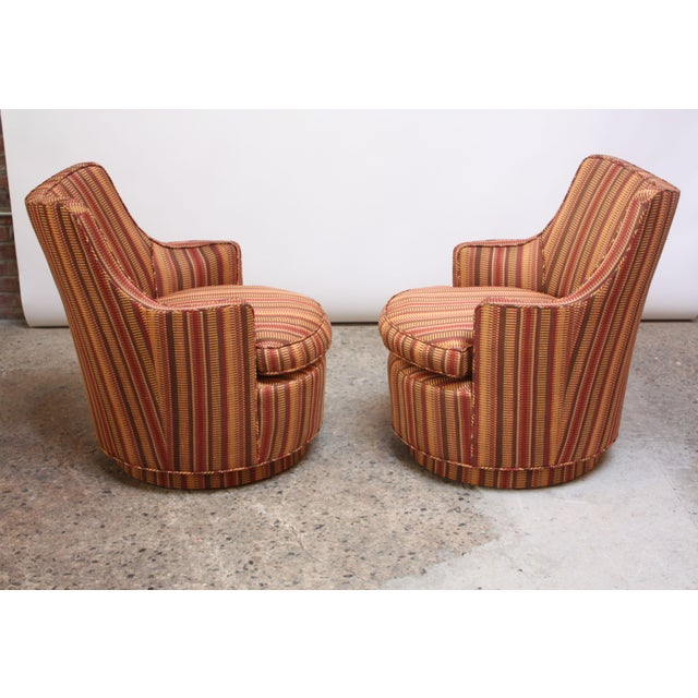 Small scale Mid-Century Modern armchairs with swivel function reminiscent of Edward Wormley's design for Dunbar but...