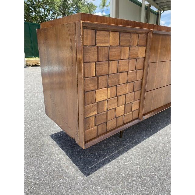 Modernist 9-drawer dresser by John Stuart, Classic Mid-Century Modern design, superior quality and construction, brass...
