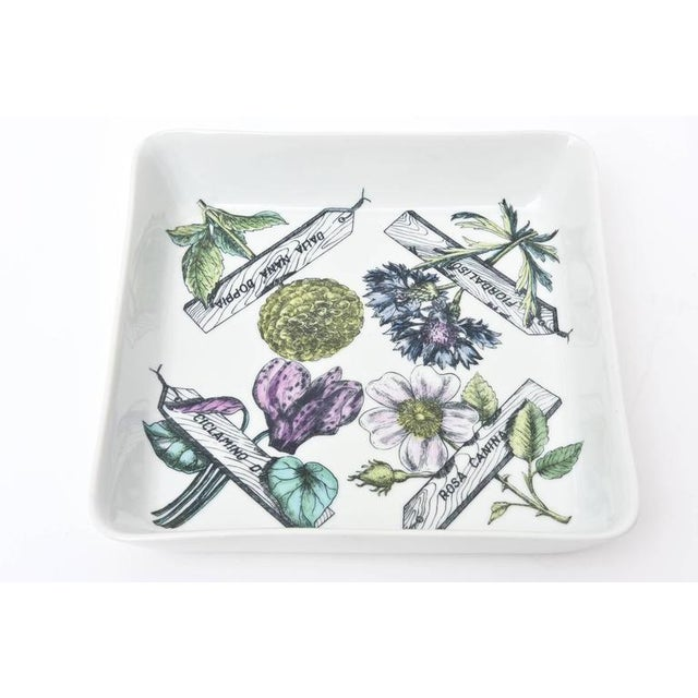This wonderful substantial sized porcelain vintage Fornasetti bowl or serving piece has all the elements of botanicals...