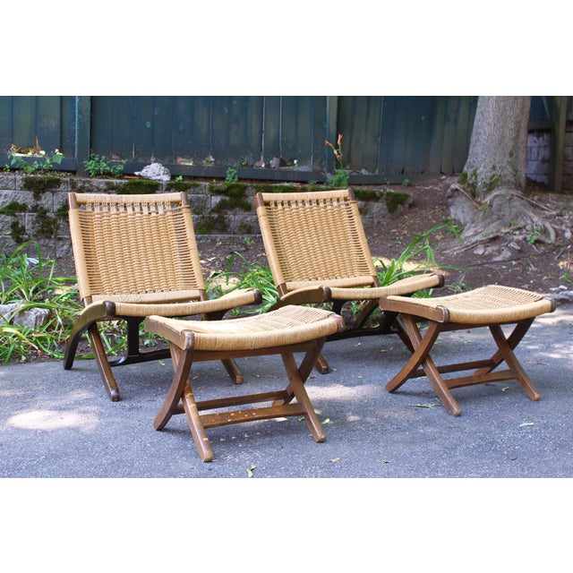 A terrific pair of woven rope chairs and matching stools in the style of Hans Wegner. These vintage pieces are very well...