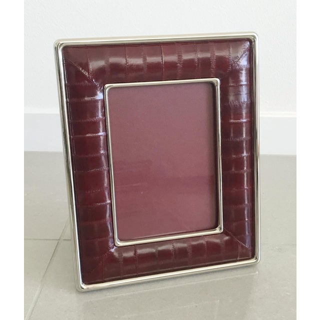Burgundy eel leather and nickel-plated picture frame by Fabio Ltd Height: 10.5 inches / Width: 8.5 inches / Depth: 1 inch...
