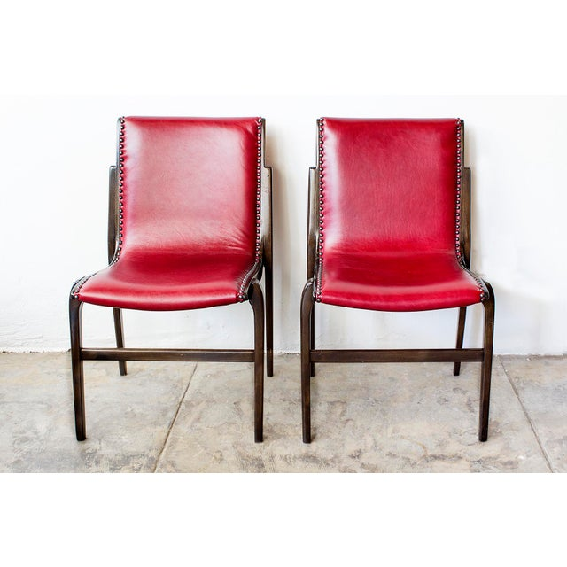 A most interesting pair of bentwood Swedish armchairs by Axel Larsson for Kungsör Stolen, circa 1950s. Features ebonized...
