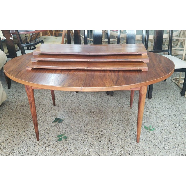 1960's Mid-century modern Danish modern style rosewood dining table sold as found previously owned showing normal signs of...