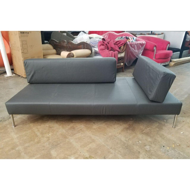 This sofa was never sold with real leather, we had it reupohlstered that way. It only comes in eco leather or vinyl....