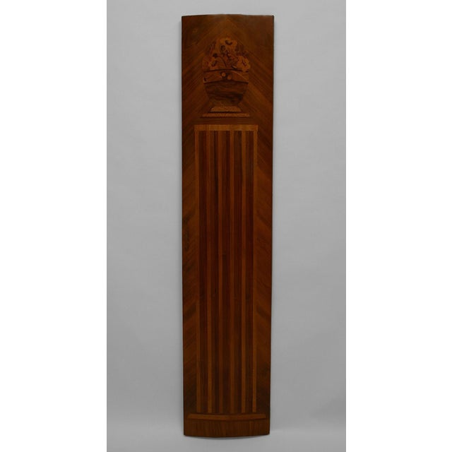 Pair of French Art Deco kingwood veneered pilaster panels with a slight convex shape and inlaid with various woods with a...