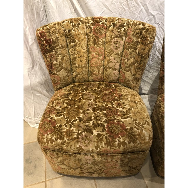 Sweet, floral pattern velvet slipper chairs are perfect for boudoir. They are on small rollers in good working condition.