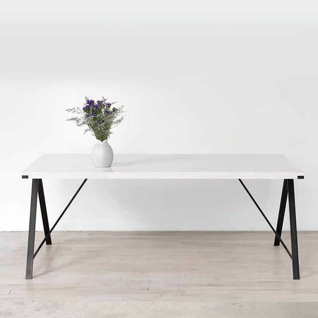 The clean lines and simple form of the A-Table convey a sense of lightness and precision. A small reveal at the corners...