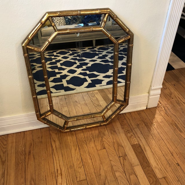 Gold faux bamboo mirror. It has 2 manufactures brackets for easy safe hanging. Original factory finish. Super cute faux...
