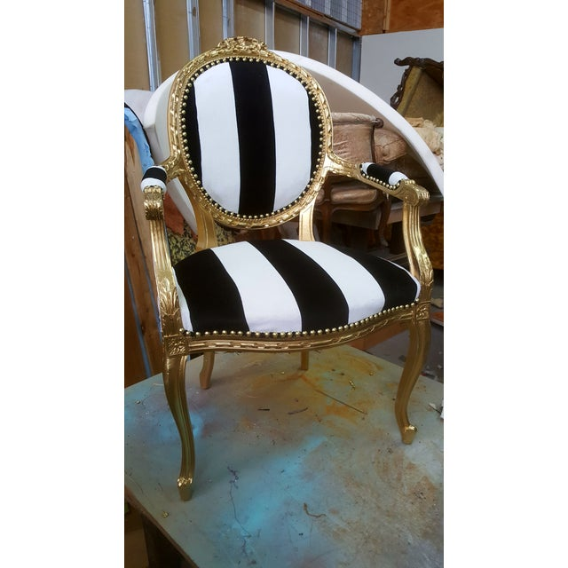 This is a custom antique Louis XVI chair in gold leaf with black and white striped velvet. It is a professionally...