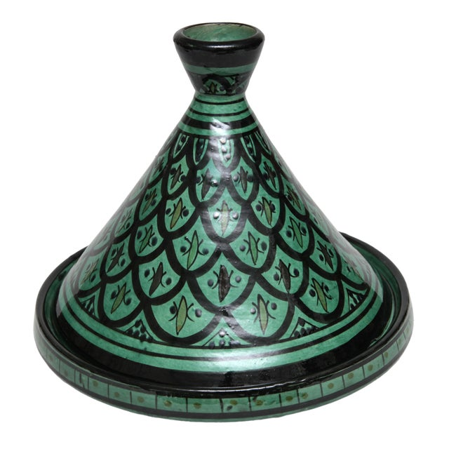 Handmade and hand-painted decorative ceramic tagine made by the Berbers in the High Atlas Mountains of Morocco.