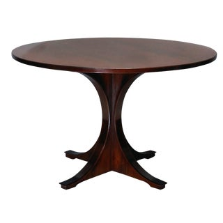 A Mid-Century Rosewood Dining Table For Sale