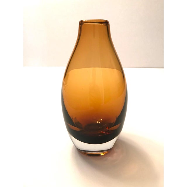 Mid-century modern handblown glass vase in hues of amber. Features submerged cased glass in amber floating over a...