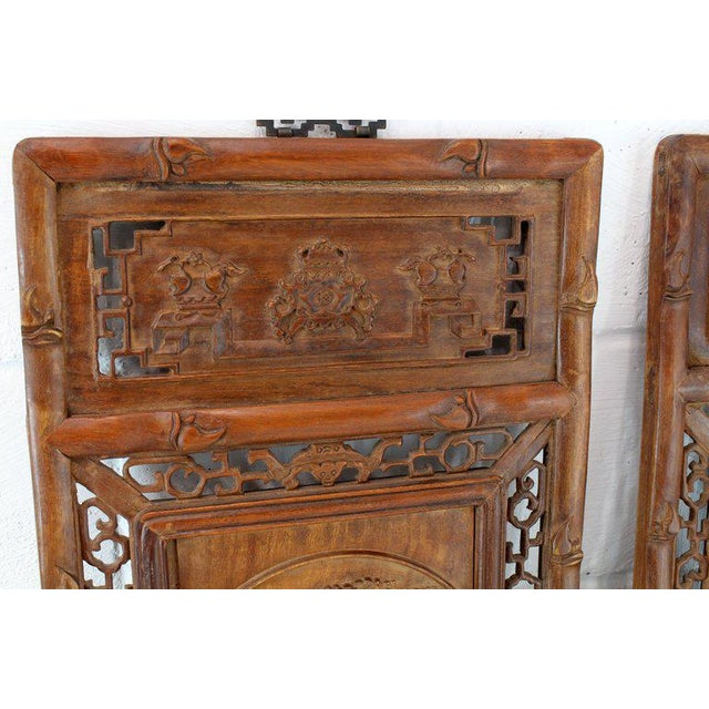 Carved teak faux bamboo frame decorative Oriental wall hangings panels ornaments. Made in the 1920s.