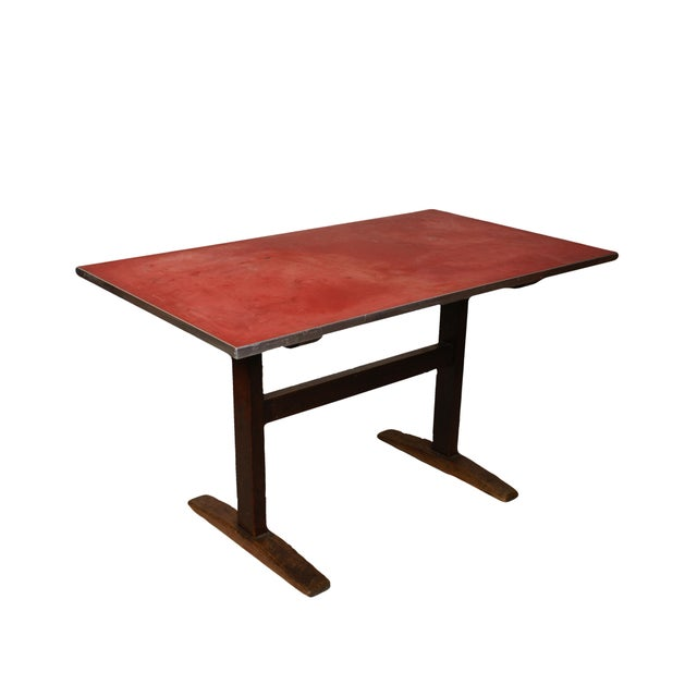 This versatile desk or table, featuring a wooden base with metal-trimmed linoleum covered top held in place with wooden...