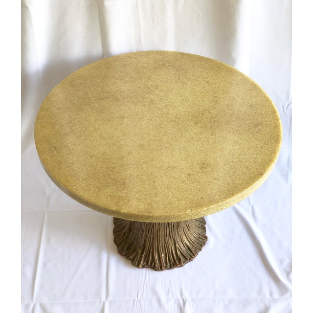 Vintage side table with Quartz top and carved metal base. Beautiful and very detailed work on the base!