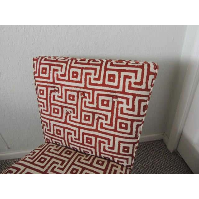 Mitchell Gold + Bob Williams red and natural accent chair. MG+BW armless swivel chair, upholstered in a custom Greek key...