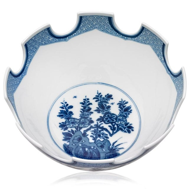This is a very large and beautifully appointed Mottahedeh Chinease Import blue and white Porcelain Bowl. It is a...