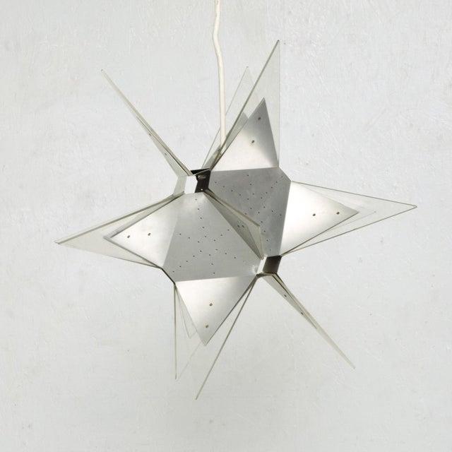 For your consideration a rare Mid-Century Modern Pop Art aluminum and plexiglass Moravian Star pendant lamp. Italy, circa...