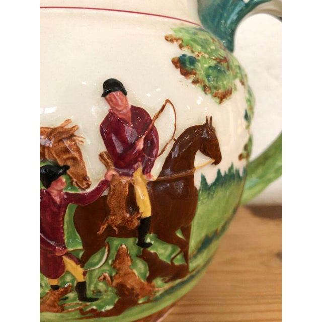"Vintage Wedgewood pitcher depicting a fox hunt. Beautiful coloring and details throughout. Features a hound handle. 8.5""W..."