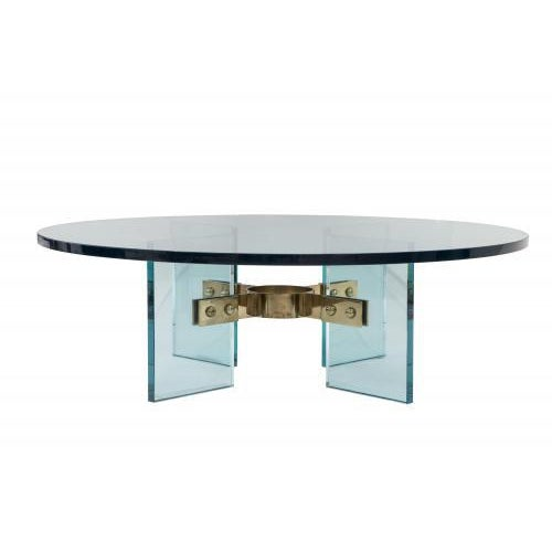 """Shown with a 1"""" thick round glass top and antiqued brass bracket. The Jules table by Studio Van den Akker is available in..."""