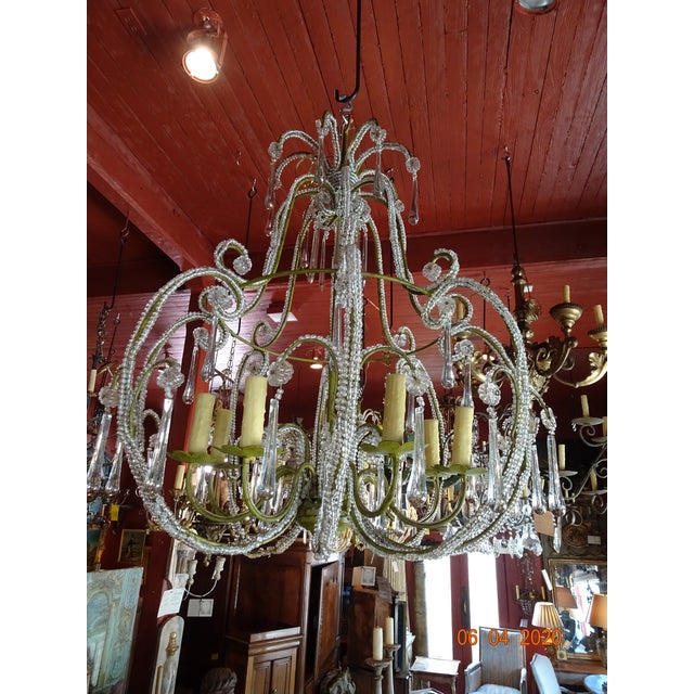 Beautiful bird cage beaded crystal French chandelier. The whole iron frame is painted in a light green and the small...
