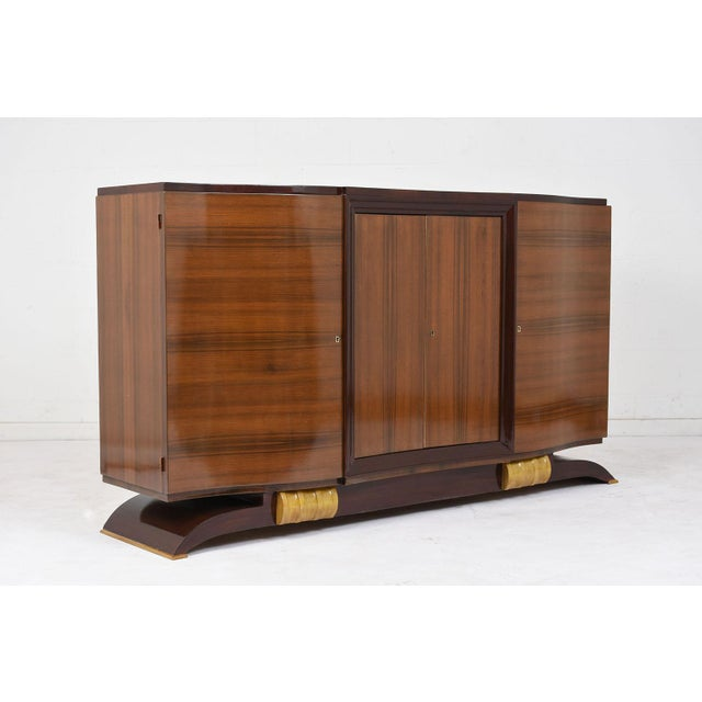 This 1930's French Art Deco-style buffet is made of mahogany finished in both a mahogany and walnut color stain with a...